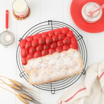 Top view red and white chigiri bubble bread, fresh viral white japanese bread, top view on black background. concept for indonesia independence day (17 agustus). roti merah putih agustusan