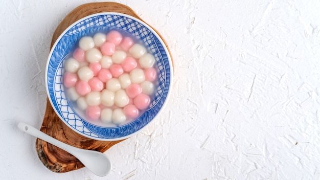 Top view of red and white tangyuan glutinous in blue bowl