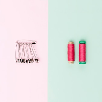 Top view reels of yarn with safety pins