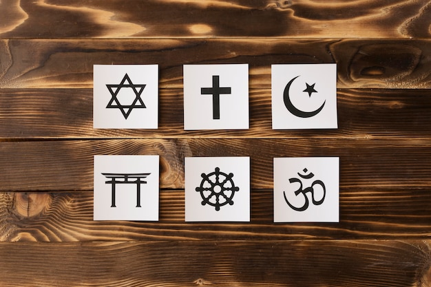 Top view of religious symbols on wooden surface