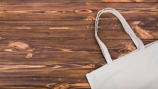 Top view of reusable bag on wooden surface with copy space