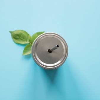 Top view of a reusable jar with a metal lid and a straw for summer drinks.