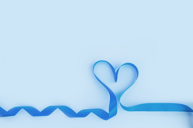 Top view of ribbon shaped as heart on blue background. valentine's day concept