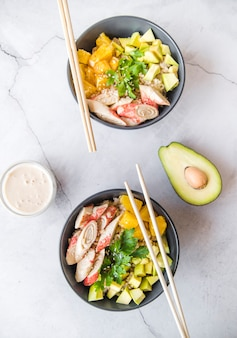 Top view rice bowls with avocado