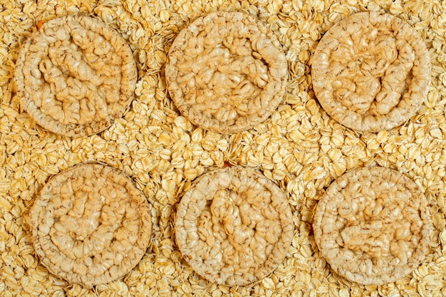 Top view of rice or corn diet bread on oat flakes