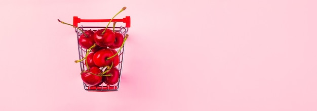 Top view of ripe cherries in a shopping cart