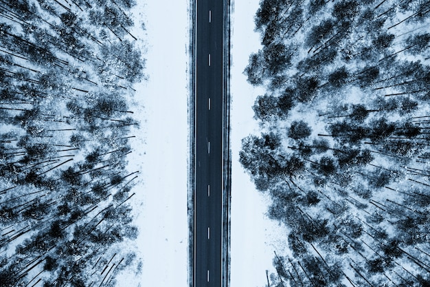 Top view of a road surrounded by snows