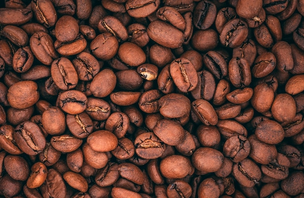 Top view of roasted coffee beans with copy space