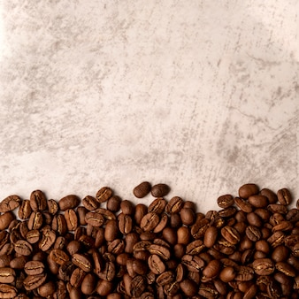 Top view roasted coffee beans with copy space Premium Photo