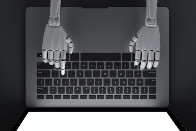 Top view of robot typing on laptop