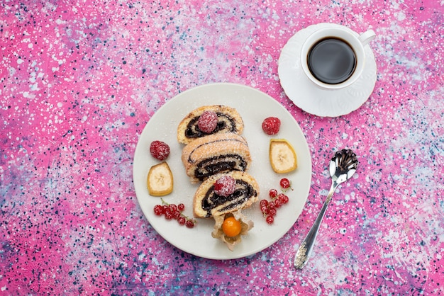 Top view roll cake slices with different fruits inside white plate along with cup of coffee on the colored background cake biscuit sweet color