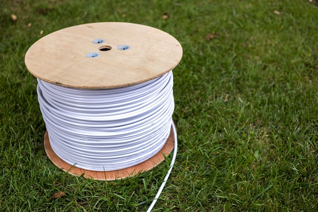 Top view of roll of white industrial electrical cable