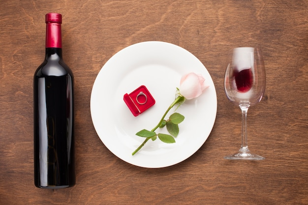 Top view romantic arrangement with wine