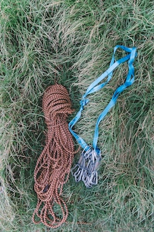 Top view of rope and carabiners in grass