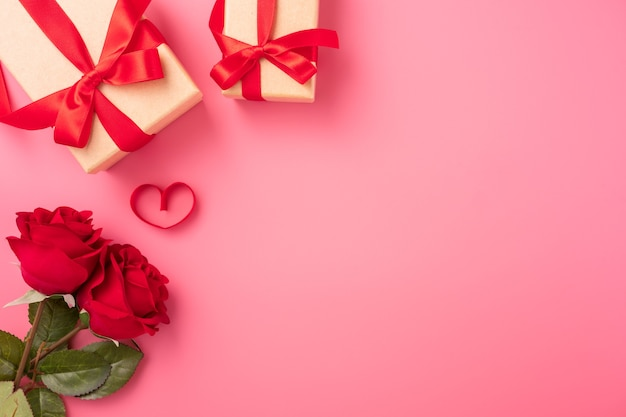 Top view of roses with heart as gift for valentine day greeting.