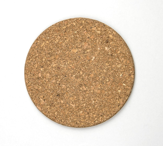 Top view of round cork isolate on white wall.