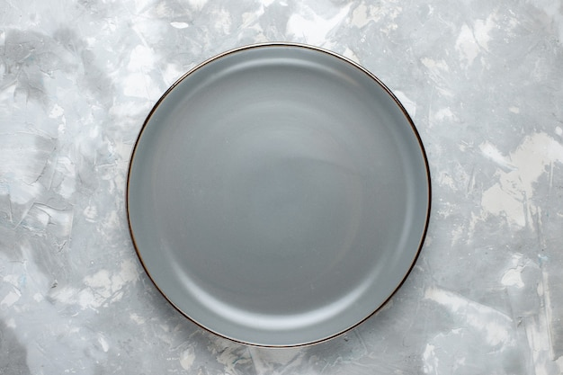 Top view round empty plate grey colored on the light-grey desk plate kitchen food color