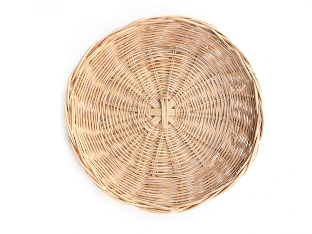 Top view of round woven bamboo basket isolated on white space