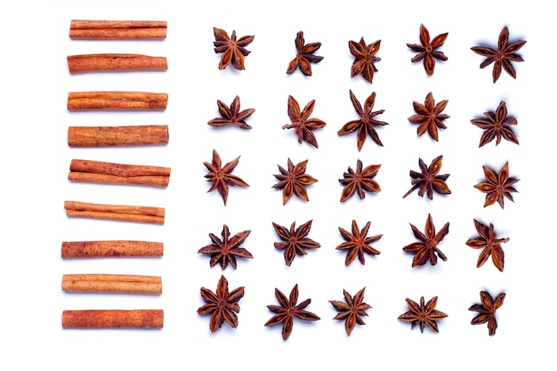 Top view row of aromatic cinnamon sticks and star anise.