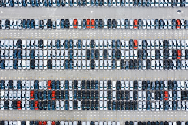 Top view of row new cars in logistic port export terminal