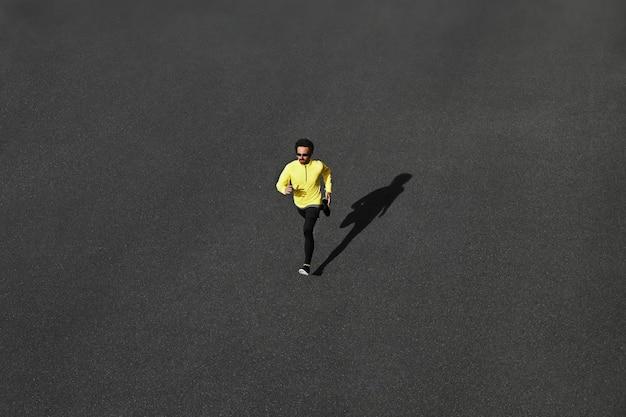 Top view runner man sprinting on road