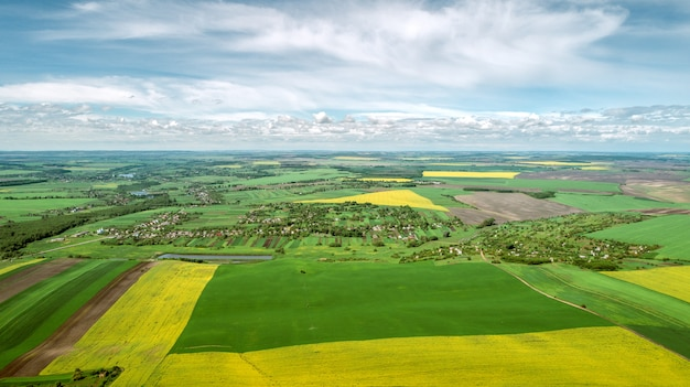 Top view of rural landscape on sunny spring day. house and green field. drone photography