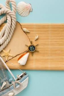 Top view sailing boat with compass on the table