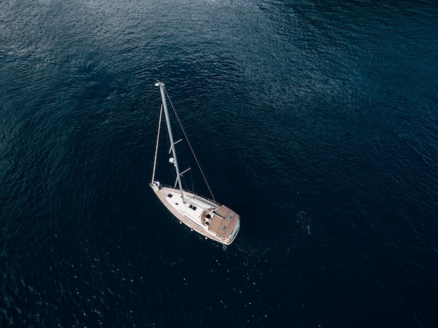 Top view of a sailing yacht sailing on the sea.