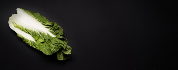 Top view salad on dark copy space background