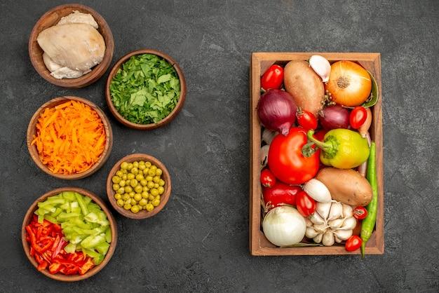 Top view salad ingredients with chicken and greens on dark desk health salad diet food