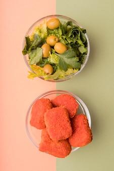 Top view salad versus unhealthy food