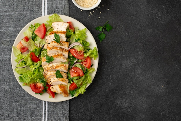Top view salad with chicken on kitchen towel with copy-space