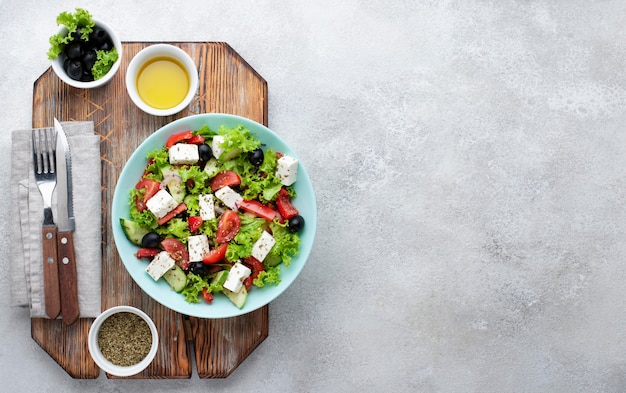 Top view salad with feta cheese on cutting board with copy-space