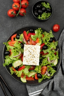 Top view salad with feta cheese, tomatoes and olives