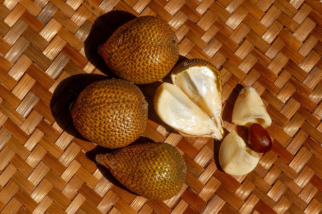 Top view of salak gading, (salacca edulis or salacca zalacca), known as snake fruit or snake skin fruit, a species of palm tree (family arecaceae) native to java, bali, and sumatra island in indonesia