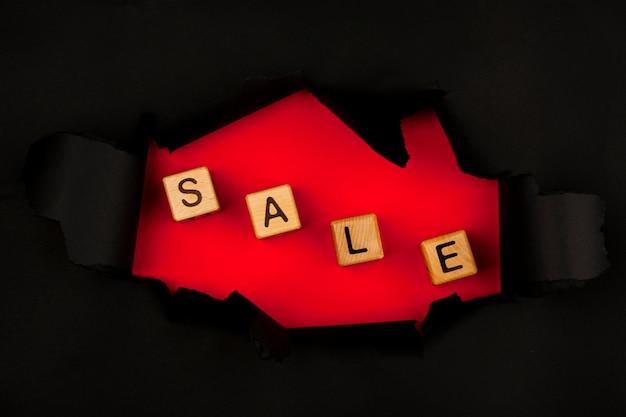 Top view of sale cubes through black paper