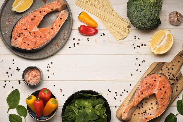 Top view salmon steak and lemon with ingredients