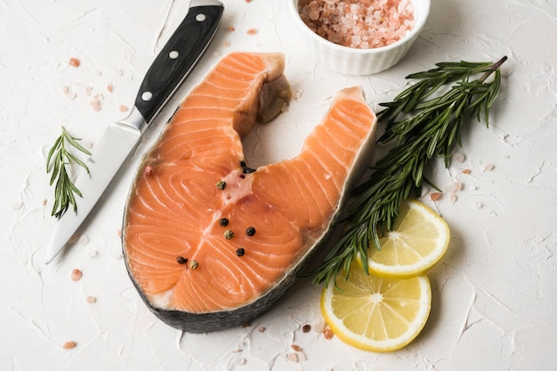 Top view salmon with herbs and lemon