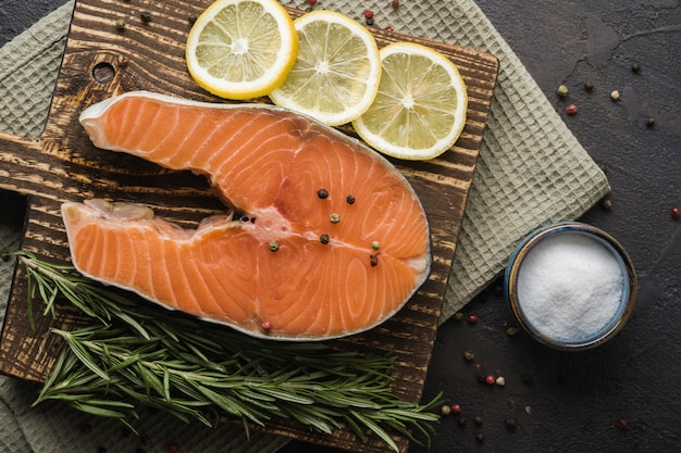 Top view salmon with lemon and herbs