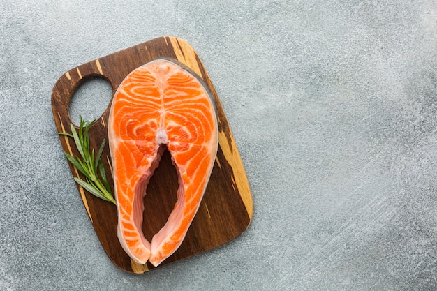 Top view salmon on wooden board