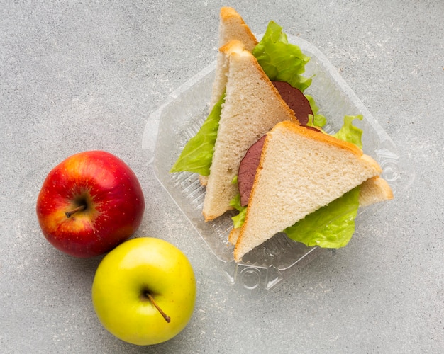 Top view sandwiches and apples arrangement