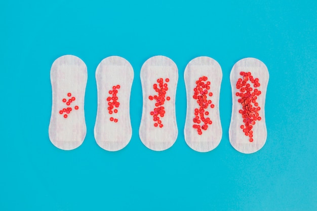 Top view sanitary towel with red sequins
