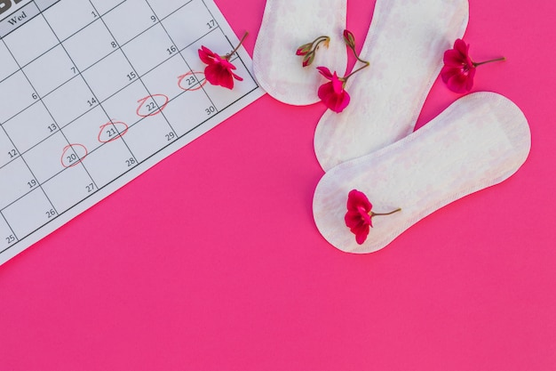 Top view sanitary towels with flowers