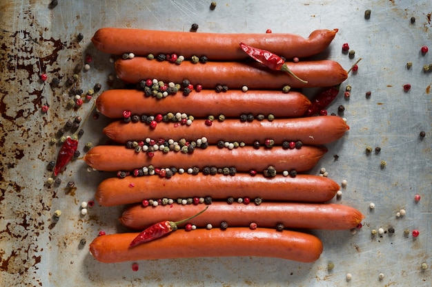 Top view sausages with pepper on tray