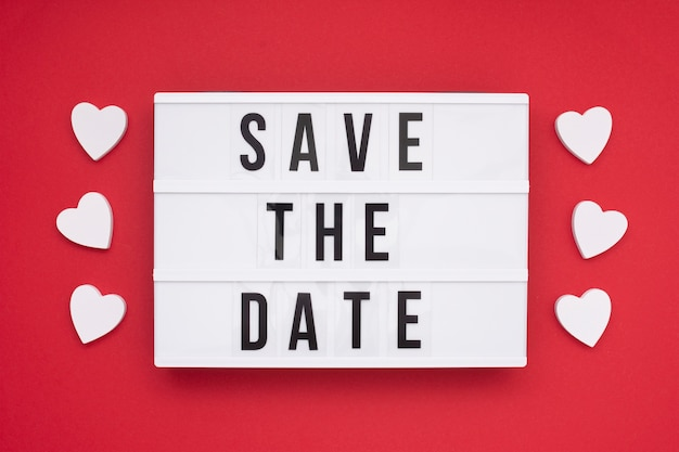 Top view save the date message with red background