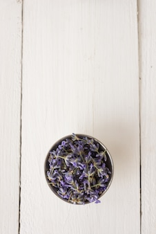 Top view in the saw lies freshly cut lavender for an aroma spa procedure. top view