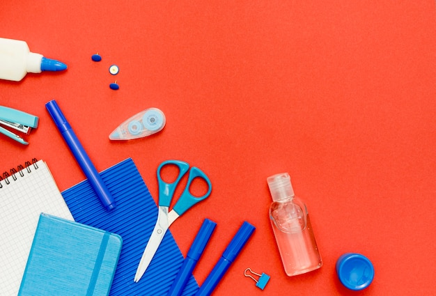 Top view school items on red background