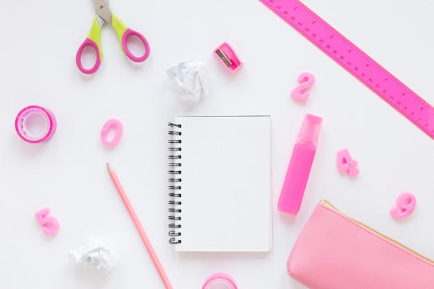 Top view school pink stationery items
