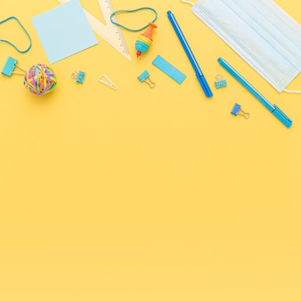 Top view of school supplies with copy space