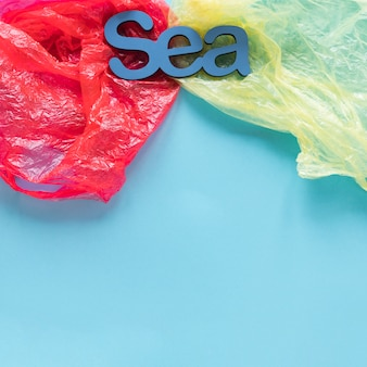 Top view of sea surrounded by plastic bags